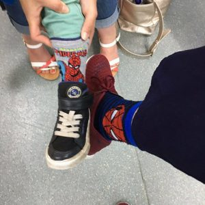 Michael Kuo and his patient wearing matching Spider-Man socks