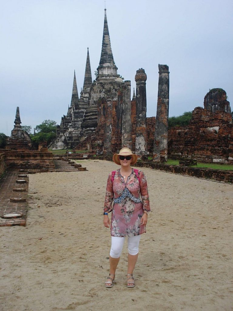 Speech and Language Therapist & Dyslexia Teacher, Mrs Leona Talsma, standing in front of Landmark in Thailand